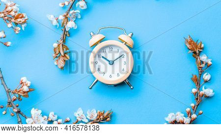 Summer Time. Spring Blossom And April Floral Nature With Alarm Clock On Blue Background. Beautiful S