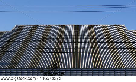 Zinc roof. Color zinc tile with geometric effect, texture style, scene or abstract background, panoramic view, with blue sky in the background Brazil,