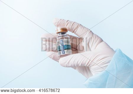 No Logos Or Trademarks!  Self Made Labels! Close Up View Of Doctor's Hand With An Ampule Of Covid Va