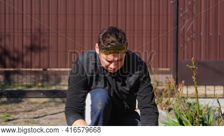 Defocus Young Construction Worker In Yellow Glasses With Puffy Cheeks Removing Irregularities On Flo