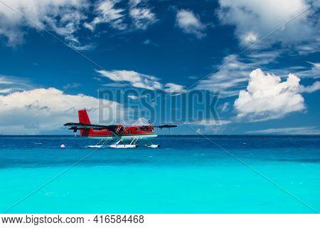 Twin otter red seaplane at Maldives