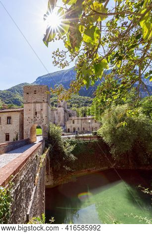 View Of Roman Catholic Abbey (san Vittore Alle Chiuse) From The Medieval Bridge. Genga, Marche, Ital
