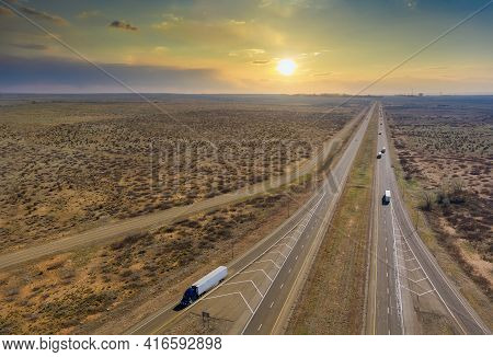 Panorama Sunset View Of Highway In America Located West In Desert Environment Near San Jon New Mexic