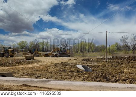 Heavy Excavator Working During Road Works, Construction Of The For New Road Construction Site On Bac