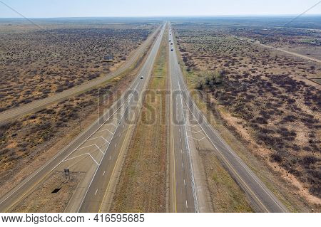 Aerial View Highway With Of Long Lane Road Through Desert Landscape Towards Near San Jon New Mexico