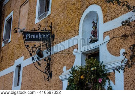 Hallstatt, Austria - March 4, 2017: View Of An Entrance To The Brauhaus, A Traditional Local Brewery