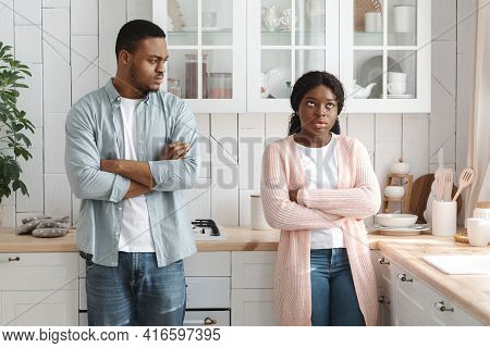 Misunderstanding In Relationship. Portrait Of Young Black Couple Standing Offended After Quarrel