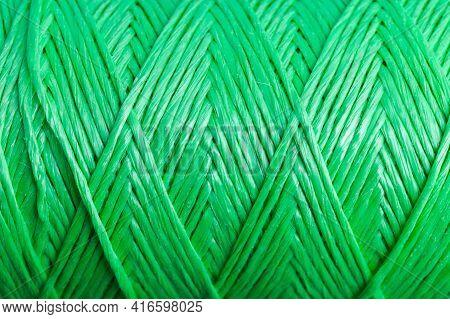 Pattern Of Twisted Green Polypropylene Cord, Closeup Photo