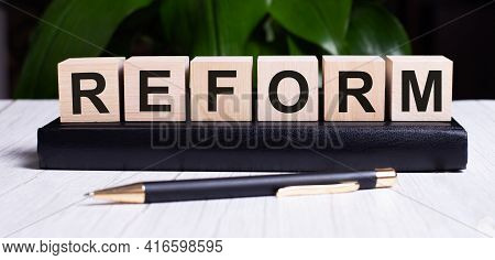 The Word Reform Is Written On The Wooden Cubes Of The Diary Near The Handle.