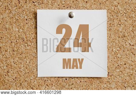 May 24. 24th Day Of The Month, Calendar Date. White Calendar Sheet Attached To Brown Cork Board. Spr