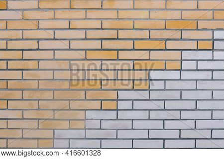 Brick Wall. Red And White Bricks. The Horizontal Part Of The Wall Is Made Of White And Yellow Bricks