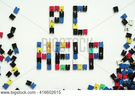 Computer Help. It Service. Pc Support. Close-up Of Computer Jumpers Spelling Pc Help