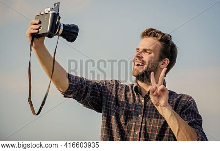Blogger Shooting Vlog. Vacation Time. Handsome Blogger Guy Traveler Retro Camera. Guy Outdoors Blue