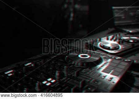 Dj Console For Mixing Music With Blurry People Dancing At A Nightclub Party. Black And White With 3d
