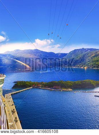 People Flying At High Zipline On Caribbean