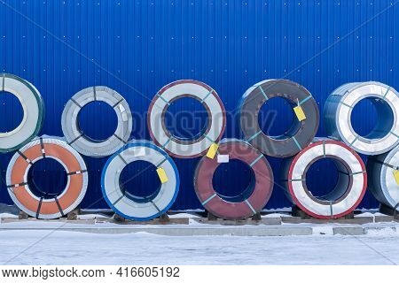 Coils Of Sheet Steel Stored Outdoors, Winter.