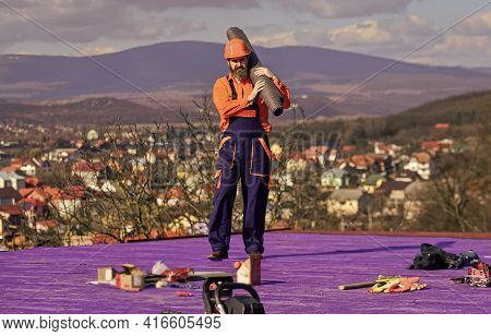 Building House. Install Vapor Barriers Or Layers Of Insulation On Flat Roofs. Roofer Constructing Ro