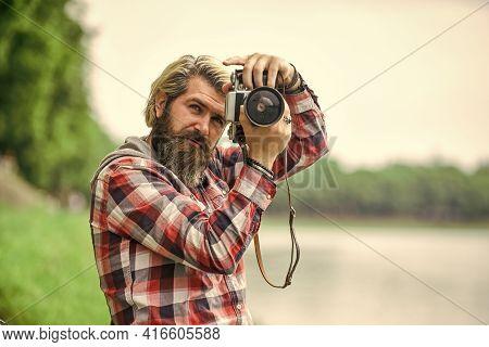 Content Creator. Masterpiece Shot. Man Bearded Hipster Photographer Hold Vintage Camera. Photographe