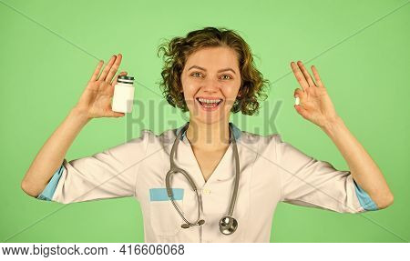 Give Her Instruction. How To Take Pill Correctly. Pill In Doctor Hand. Hospital Medical Expert Show