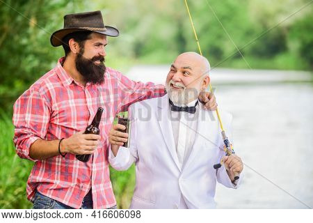 Pleasant Time. Two Fishermen With Fishing Rods. Summer Family Weekend. Father And Son Fishing. Retir
