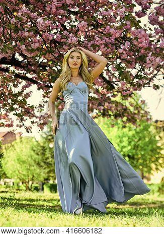 Spring Fashion Collection. Woman Fancy Dress Gown Spring Flower Sakura Bloom. Girl In Cherry Flower