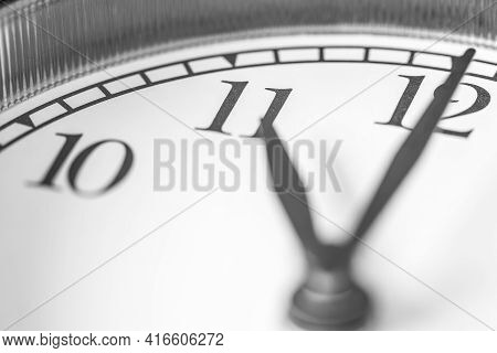 Clock Hand Pointing Eleven O'clock On White Clock Face Of Twin Bell Classic Alarm Clock
