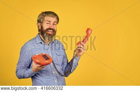 Hello 80s. Man With Moustache Holding Vintage Phone. Vintage Communication Device. Businessman Talki