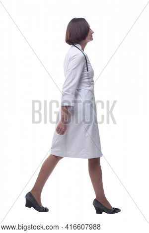 confident experienced doctor goes ahead . isolated on a white background.