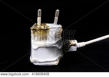 Faulty Cell Battery Charger, Short Circuit, Charred. Danger Of Domestic Accident With Cell Phone