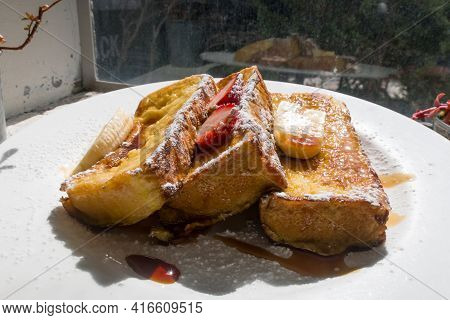 Breakfast Of French Toast With Strawberries And Syrup.