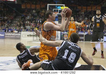 VALENCIA - JANUARY 29: #12 Serhiy Lischchuk with ball during Bakestball match between Valencia Basket Club and Uxue Bilbao, on January 29, 2013, in La Fonteta Stadium, Valencia, Spain