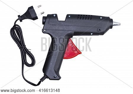 Glue Gun With Electric Cord On White Isolated, Black Object, Close-up.