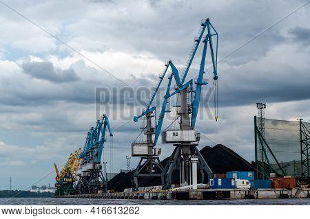 Coal Industry. Blue Working Coal Cranes In The Industrial Port.