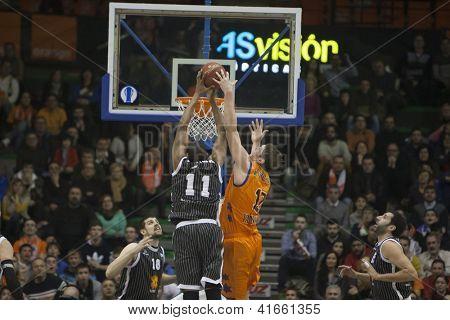 VALENCIA - JANUARY 29: #11 Lamont Hamilton & Serhiy Lishchuk during Bakestball match between Valencia Basket Club and Uxue Bilbao, on January 29, 2013, in La Fonteta Stadium, Valencia, Spain