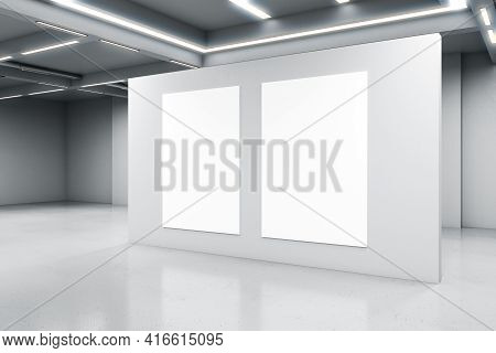 Empty Big White Room With A White Concrete Wall With Two Blank Posters In The Middle, Artificially L