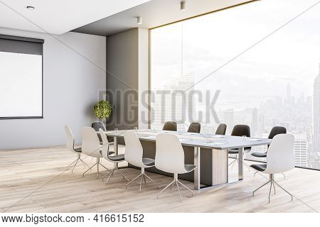 Side View On Big Conference Table In Modern Meeting Room On High Floor With Great City View Through