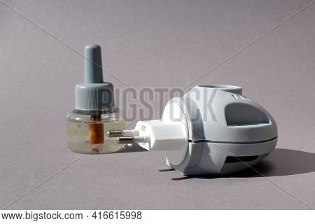 Electric Gray Mosquito Fumigator On Gray Background