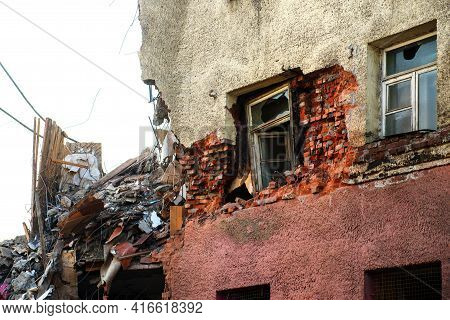 Ruins Of Building Under Destruction. Rubble Of Old Ruined House. Pile Of Construction Fragments In R