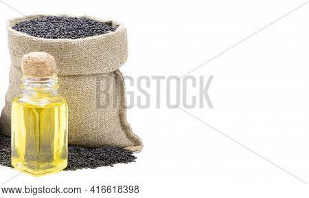 Black Sesame Essential Oil. Glass Bottle Of Black Sesame Oil. Black Sesamei N A Sack Of Isolated On