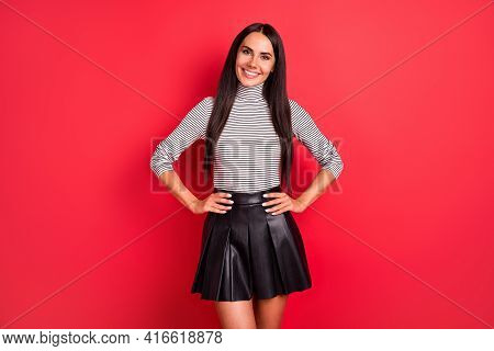 Photo Of Young Pretty Positive Charming Pretty Lovely Girl Hold Hands On Waist Posing On Camera Isol