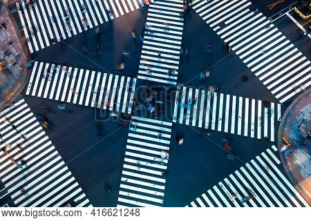Traffic And People Cross A Busy Intersection In Ginza, Tokyo