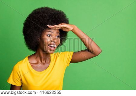 Photo Of Young Happy Excited Crazy Afo Woman Looking Forward Ahead In Copyspace Isolated On Green Co