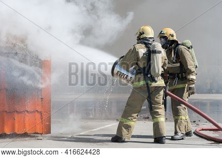 Firefighters Extinguishes Fire From Fire Hose, Using Firefighting Water-foam Barrel With Air-mechani