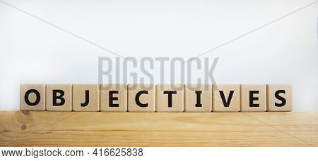 Objectives Symbol. Word 'objectives' Written On Wooden Blocks. Business And Objectives Concept. Copy