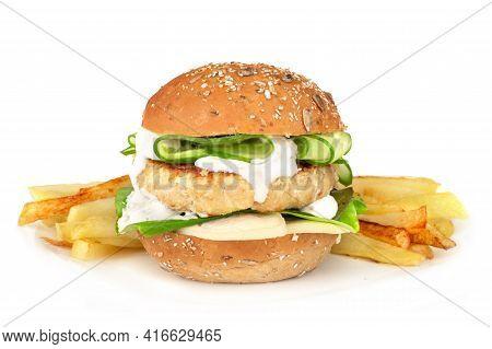 Fishburger Fish Burger With Cod Cutlet Cucumber Lettuce Goat Cheese Dzatziki Tartarus Sauce On Grain