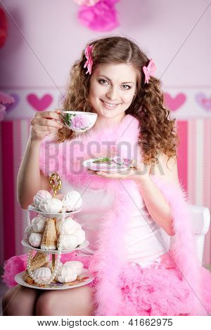Sexy sweet young woman in pink room