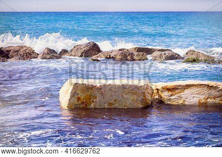 A Stone Breakwater In The Sea. Non-urban Scene.