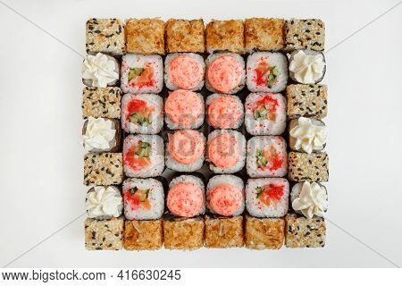 Big Sushi Set Isolated On White Background. Top View On High Quality Bright Food Photo