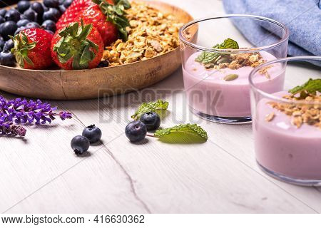 Natural Yogurt With Fresh Berries And Oatmeal. Healthy Dessert.healthy And Natural Breakfast Made Wi