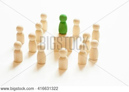 A Green Man Stands Out From The Crowd. Suitable Candidate. An Initiative And Active Person. Employee